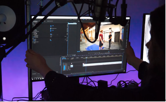 YouTuber Tim Jacken adjusting the height of his LG UltraGear monitor to position it in the perfect place for maximum productivity.