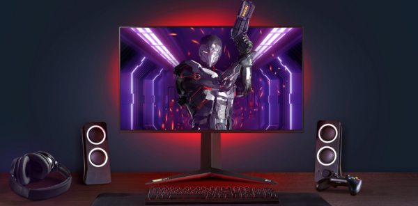 The complete gaming setup boasting an LG UltraGear™ gaming monitor which is displaying a futuristic shooting title, a controller for console play, speakers, headphones and a keyboard.
